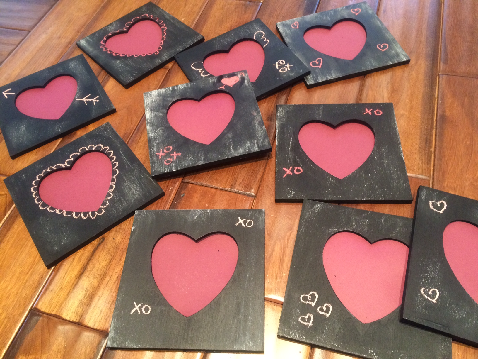 Some heart-shaped chalkboard photo frames I made for the couple's friends and family